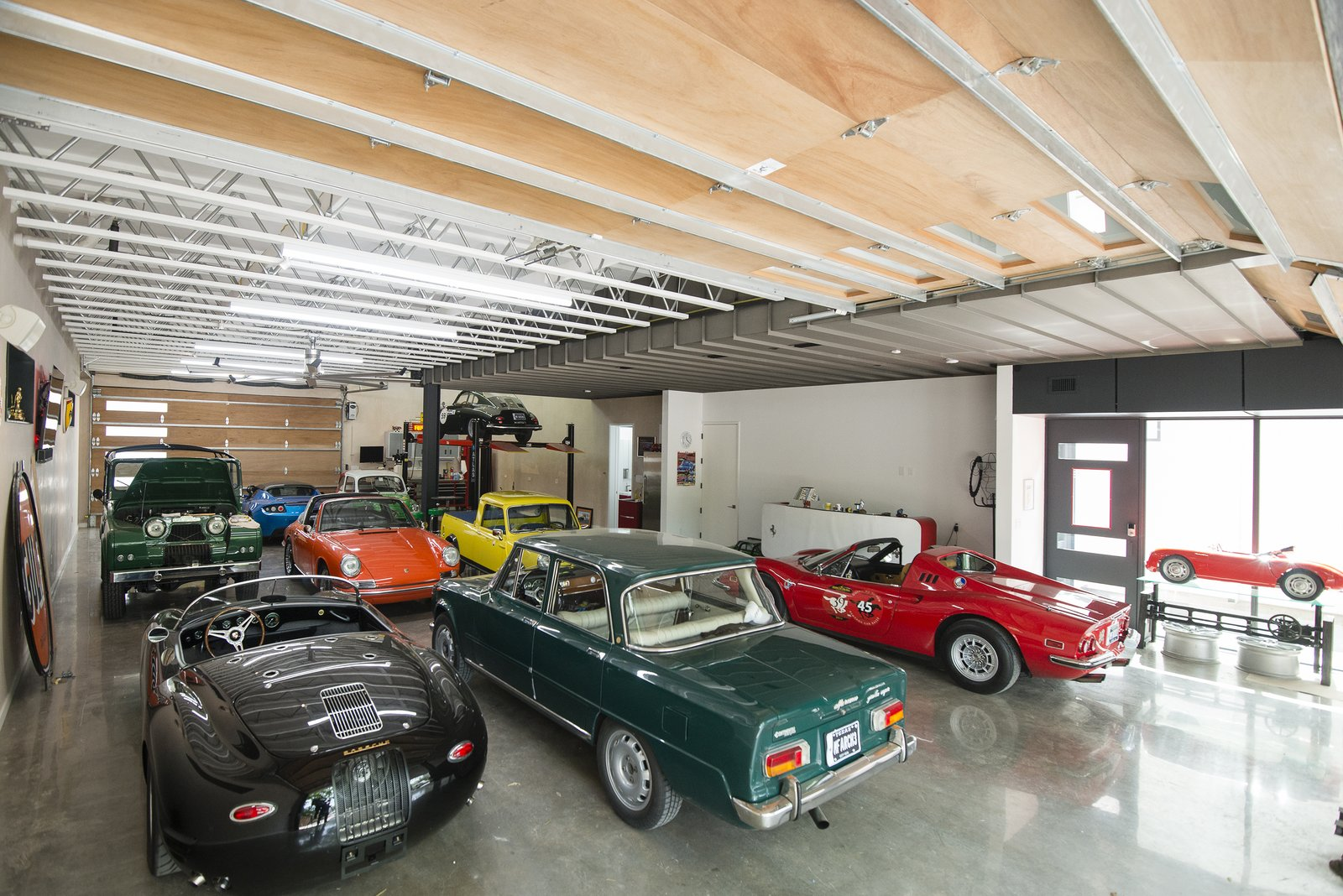 "Garage and Attached Garage Room Type  Search ""garageroom-type--attached-garage"" from This Austin Home Was Designed to Showcase a Vintage Car Collection"