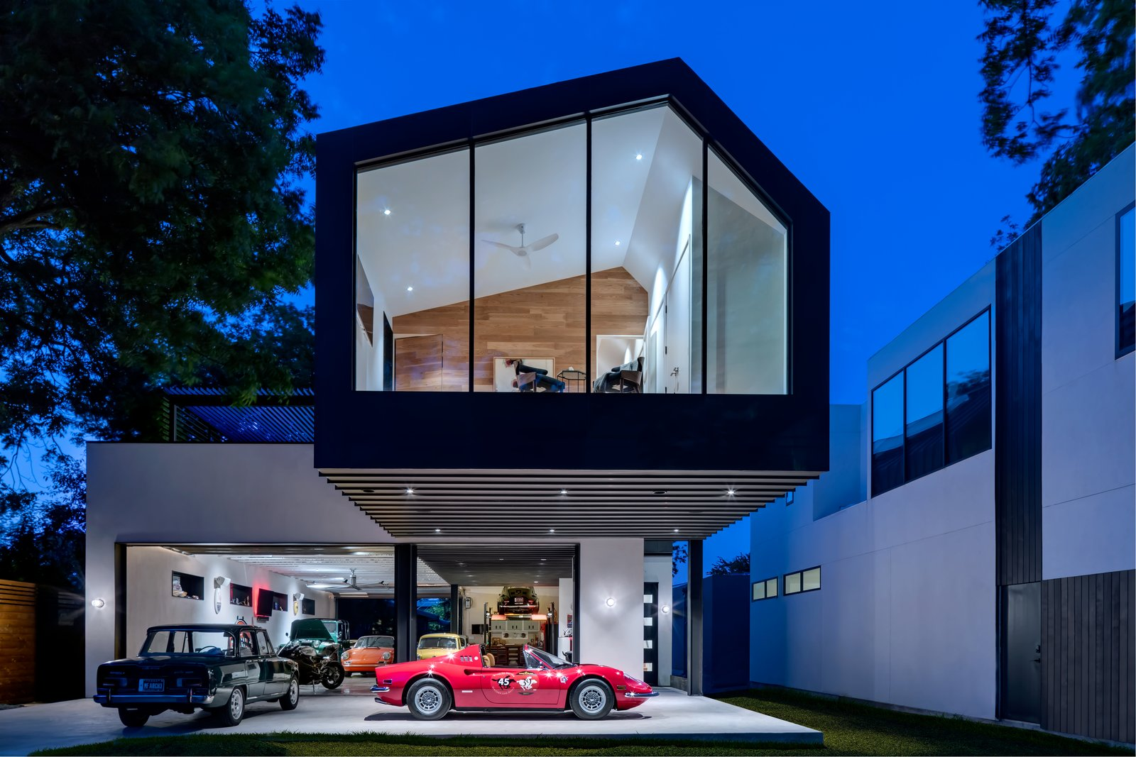 Exterior, House Building Type, Metal Siding Material, and Gable RoofLine  Photo 18 of 21 in This Austin Home Was Designed to Showcase a Vintage Car Collection