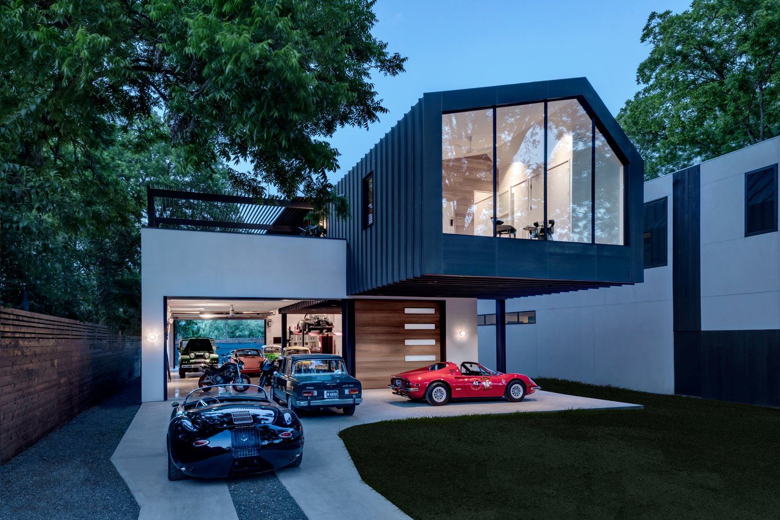 Exterior, House Building Type, Metal Siding Material, and Gable RoofLine  Photo 3 of 21 in This Austin Home Was Designed to Showcase a Vintage Car Collection