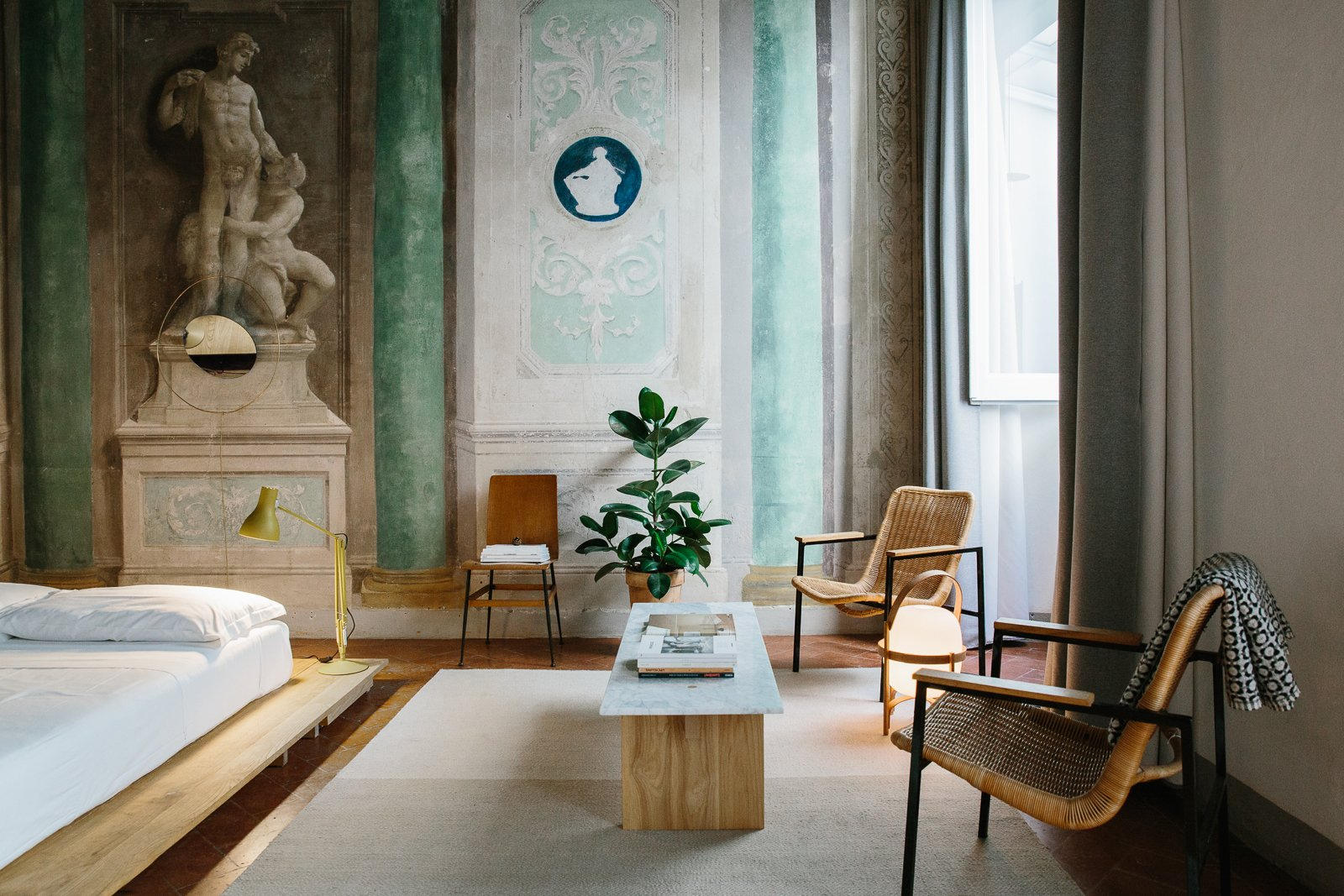 Bedroom, Floor Lighting, Table Lighting, Chair, Bed, Bench, Rug Floor, and Lamps  Best Photos from A 16th-Century Florentine Palazzo Is Transformed Into an Artist Residency