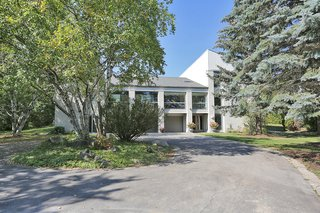 The discretely designed three-car garage centers the property and opens to a 360-degree circular driveway. A bright and airy living/music area with 22' ceiling is located above the garage.