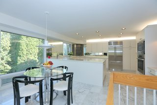 The bright and open contemporary kitchen leads out to the back patio.