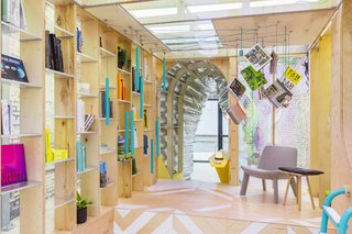 """The central volume of the home is occupied by a """"library"""" featuring books which can be retrieved randomly by pulling on the ropes which hang from the ceiling."""