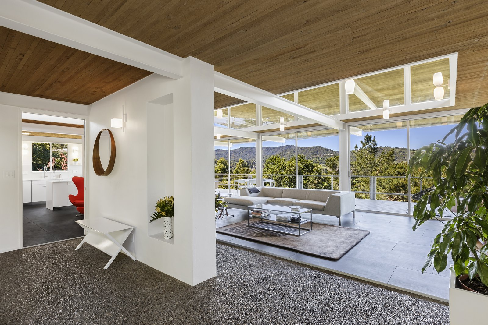 Living Room, Wall Lighting, Coffee Tables, Sectional, Concrete Floor, Rug Floor, and Console Tables  Photo 8 of 17 in Spend the Night in an Iconic Case Study House North of San Francisco