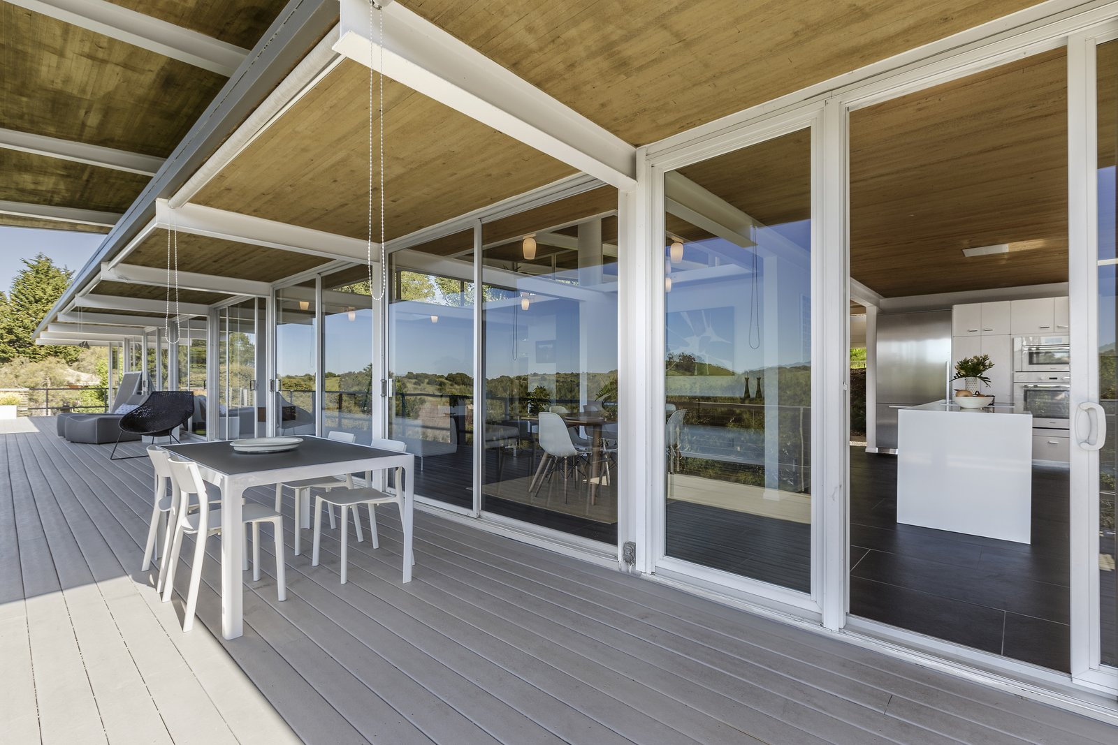 Outdoor, Large Patio, Porch, Deck, Decking Patio, Porch, Deck, and Back Yard  Photo 9 of 17 in Spend the Night in an Iconic Case Study House North of San Francisco
