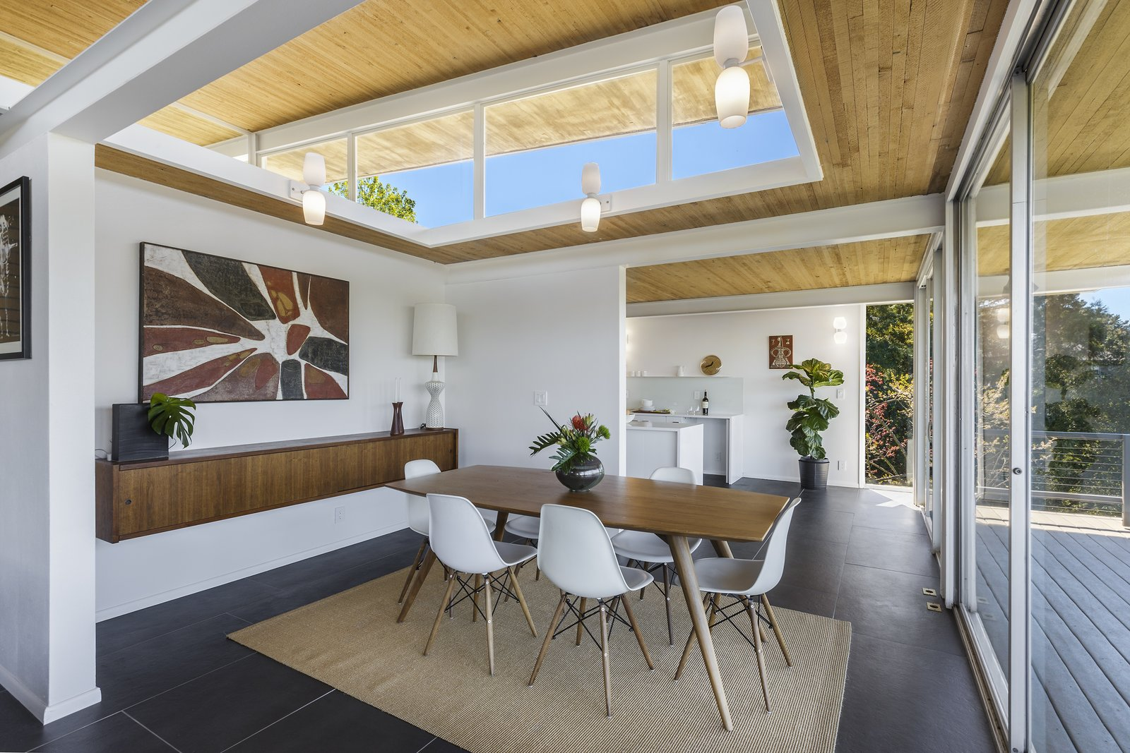 Dining Room, Table, Rug Floor, Storage, Chair, and Wall Lighting  Photo 10 of 17 in Spend the Night in an Iconic Case Study House North of San Francisco