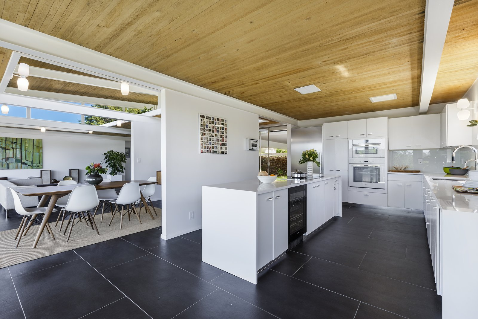 Kitchen, Wall Oven, White Cabinet, Wall Lighting, Refrigerator, Undermount Sink, Cooktops, and Beverage Center  Photo 11 of 17 in Spend the Night in an Iconic Case Study House North of San Francisco
