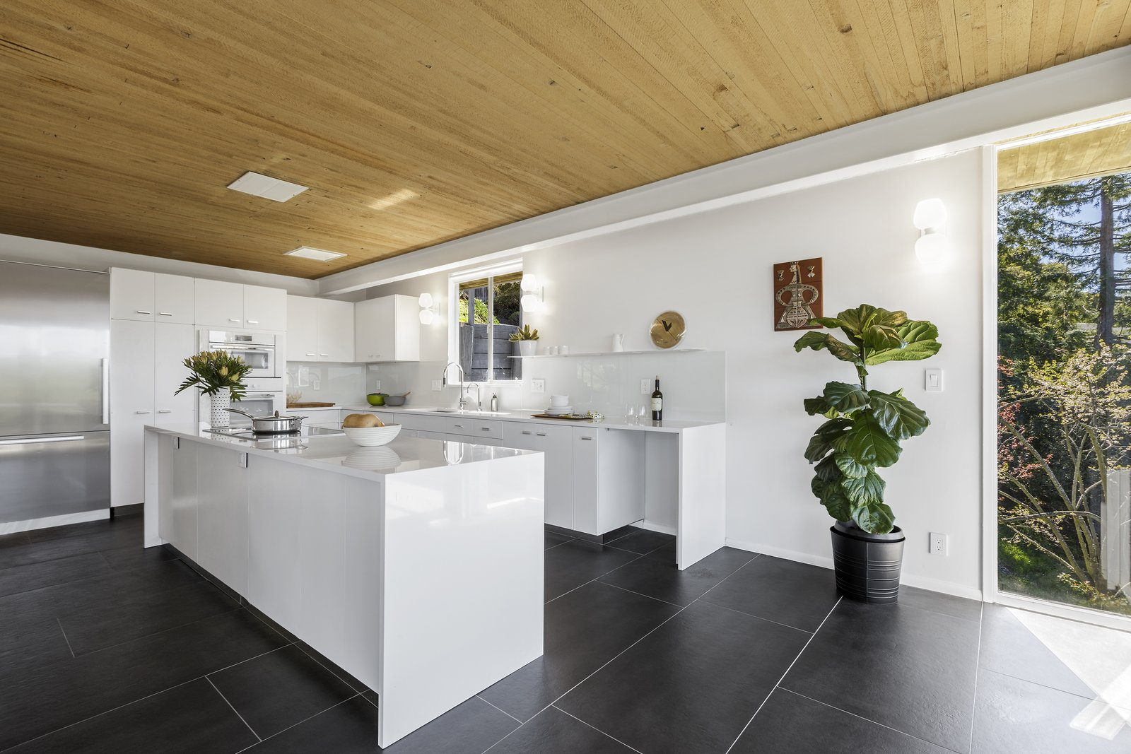 Kitchen, White Cabinet, Refrigerator, Wall Lighting, Undermount Sink, Cooktops, and Wall Oven  Photo 12 of 17 in Spend the Night in an Iconic Case Study House North of San Francisco