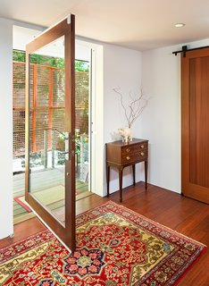 The main entrance sets the tone for the bright and airy interiors.