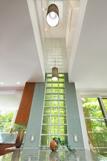 Natural lighting is not an issue despite the home's forested setting.