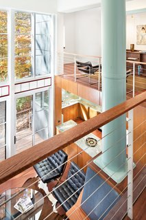 A bridge on the second floor leads from the master bedroom to the library.