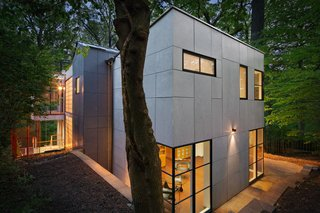 An Airy, Award-Winning Maryland Gem Hits the Market - Photo 11 of 15 - Rear house view at night.