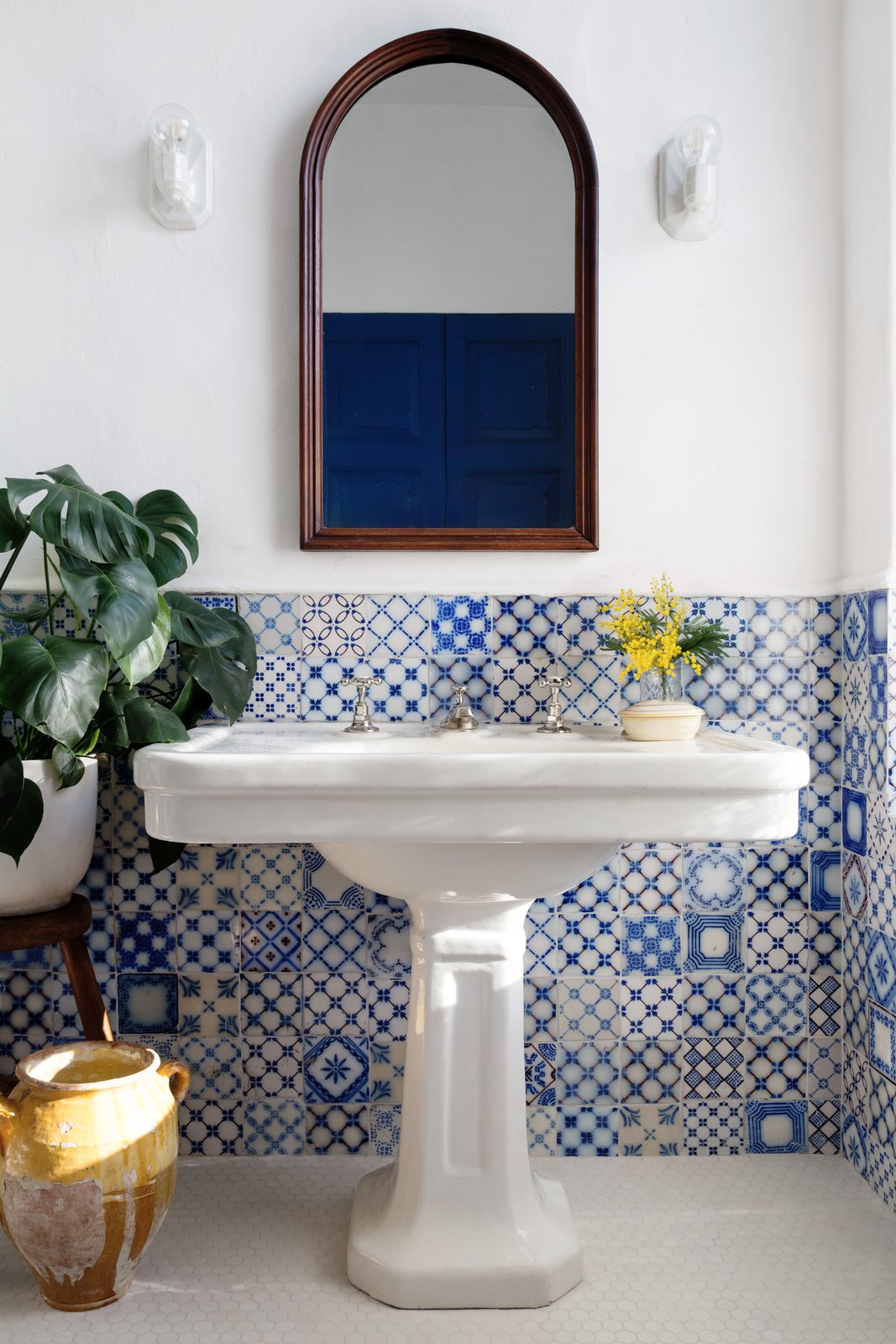 Bath Room, Pedestal Sink, Wall Lighting, and Ceramic Tile Wall  Photo 12 of 22 in A 19th-Century Schoolhouse in Brooklyn Becomes a Classy Apartment