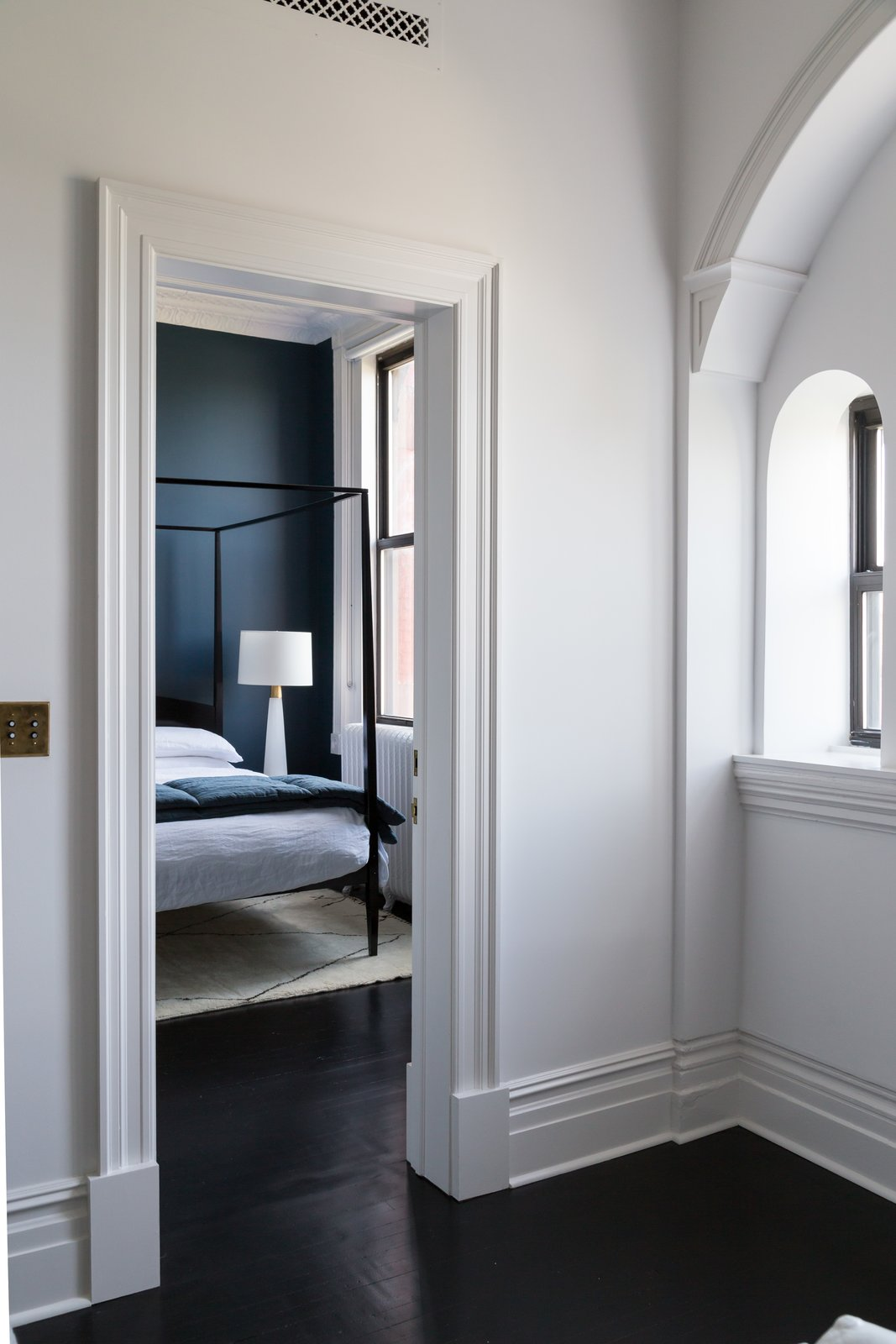 Bedroom, Bed, Table Lighting, and Dark Hardwood Floor  Photo 15 of 22 in A 19th-Century Schoolhouse in Brooklyn Becomes a Classy Apartment