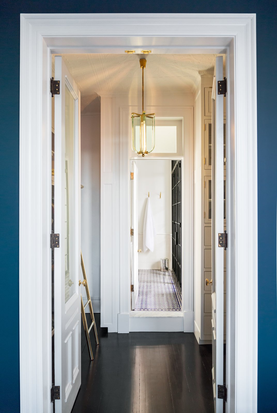 Hallway and Dark Hardwood Floor  Photo 18 of 22 in A 19th-Century Schoolhouse in Brooklyn Becomes a Classy Apartment