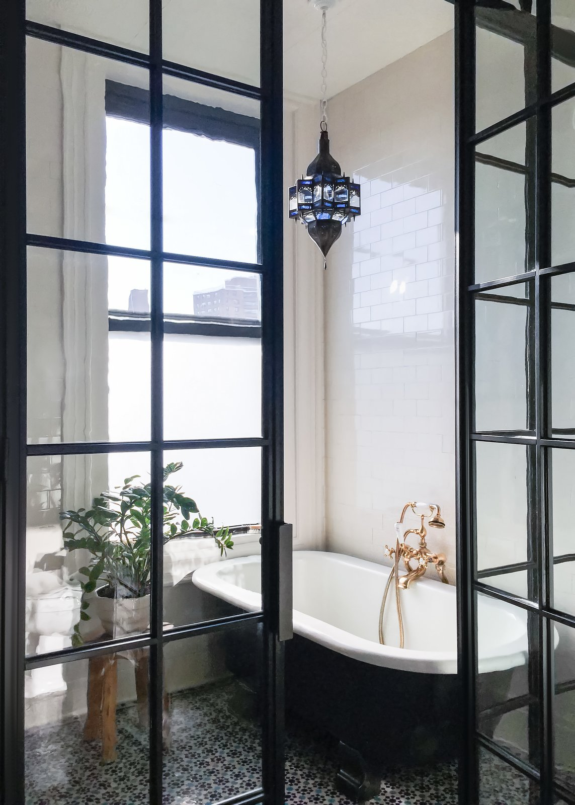Bath Room, Pendant Lighting, Freestanding Tub, Subway Tile Wall, and Ceramic Tile Floor  Photo 19 of 22 in A 19th-Century Schoolhouse in Brooklyn Becomes a Classy Apartment