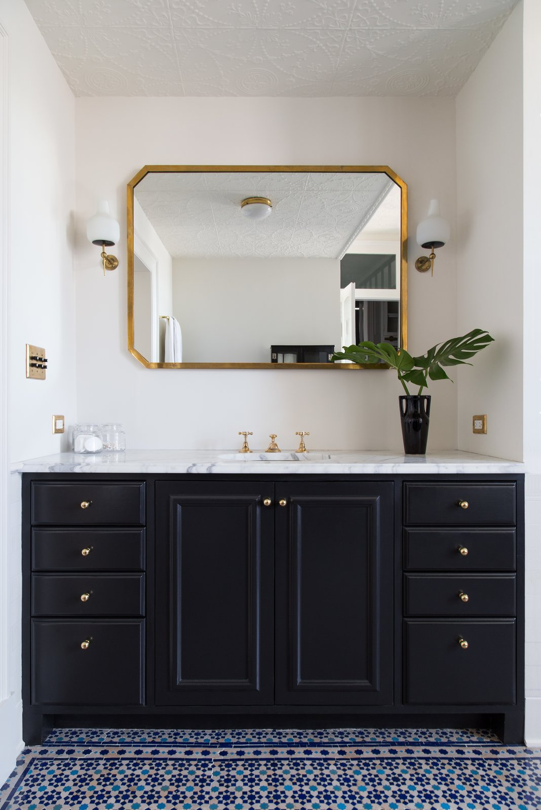 Bath Room, Marble Counter, Drop In Sink, Ceramic Tile Floor, and Wall Lighting  Photo 20 of 22 in A 19th-Century Schoolhouse in Brooklyn Becomes a Classy Apartment