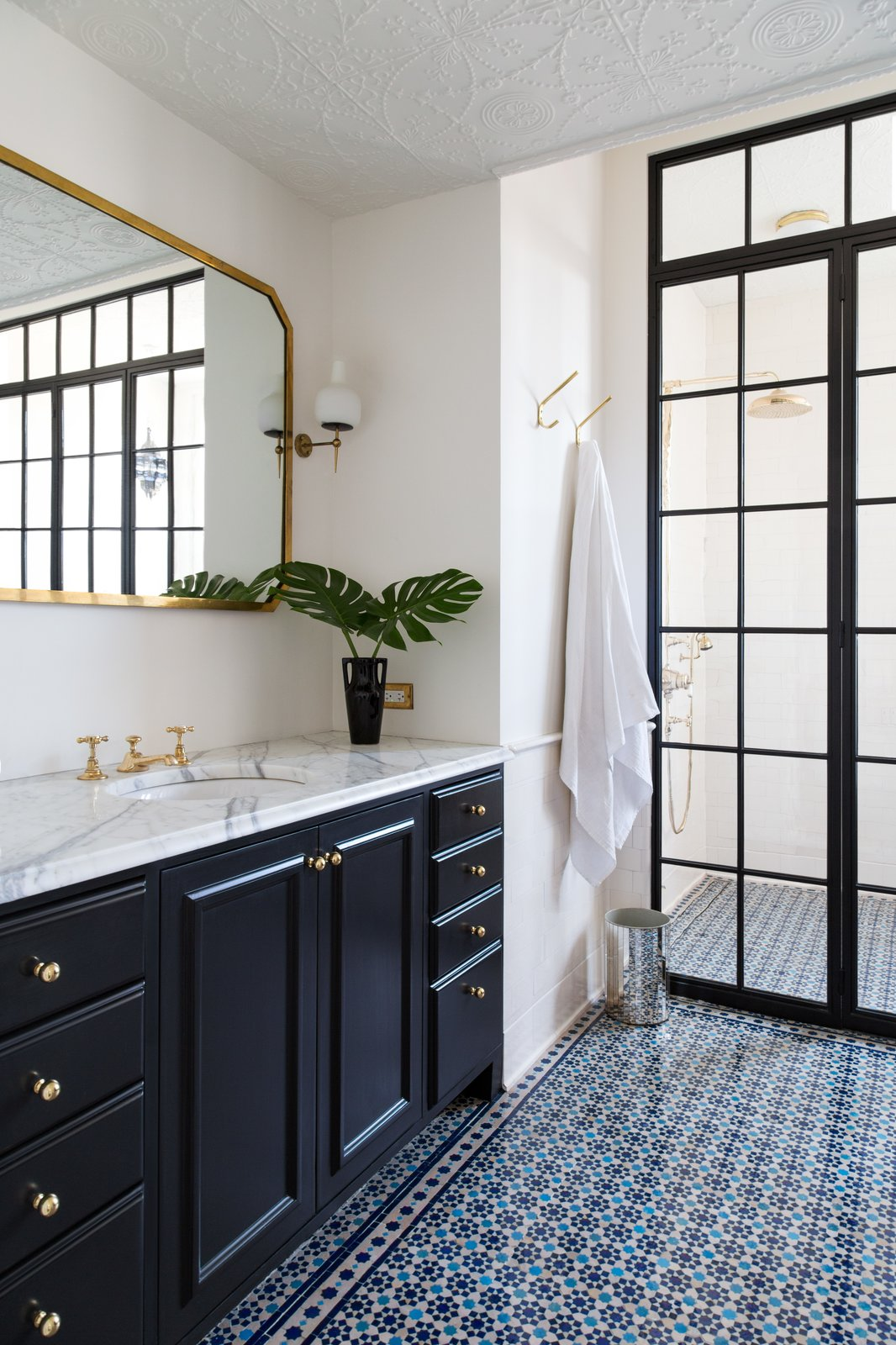 Bath Room, Marble Counter, Ceramic Tile Floor, Drop In Sink, and Enclosed Shower  Photo 21 of 22 in A 19th-Century Schoolhouse in Brooklyn Becomes a Classy Apartment