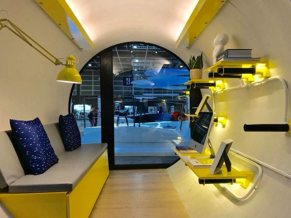 Living, Wall, Shelves, Desk, Bench, and Light Hardwood  Best Living Desk Bench Photos from These Tiny, Modular Homes Are Made of Concrete Water Pipes
