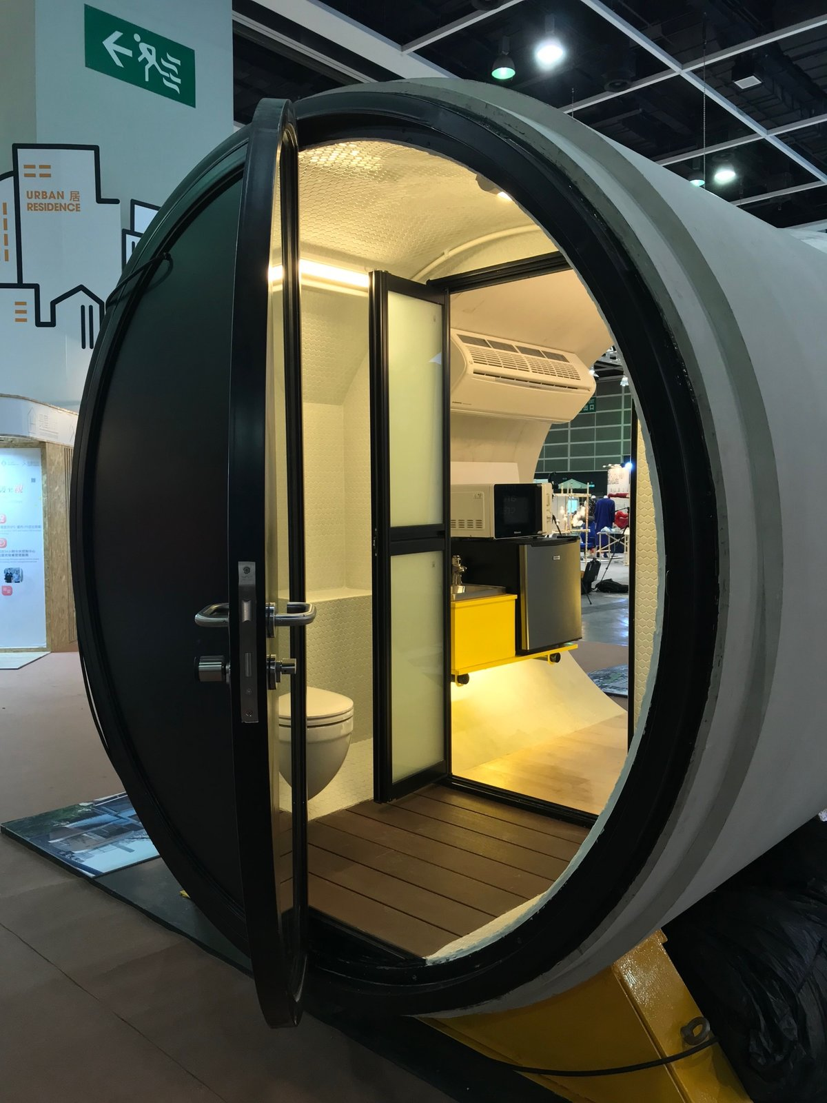 Doors, Swing Door Type, and Metal  Photo 9 of 16 in These Tiny, Modular Homes Are Made of Concrete Water Pipes