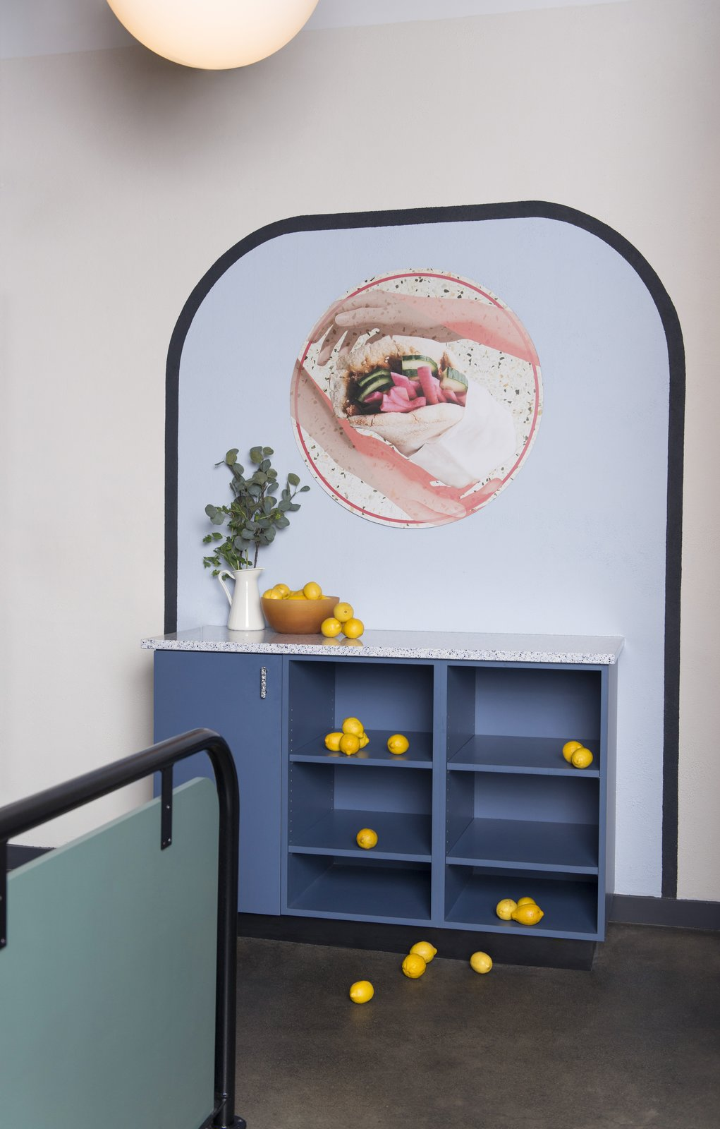 Storage Room and Cabinet Storage Type  Photo 4 of 14 in Fun, Cheeky Interiors Give This Middle Eastern Eatery a Modern Edge