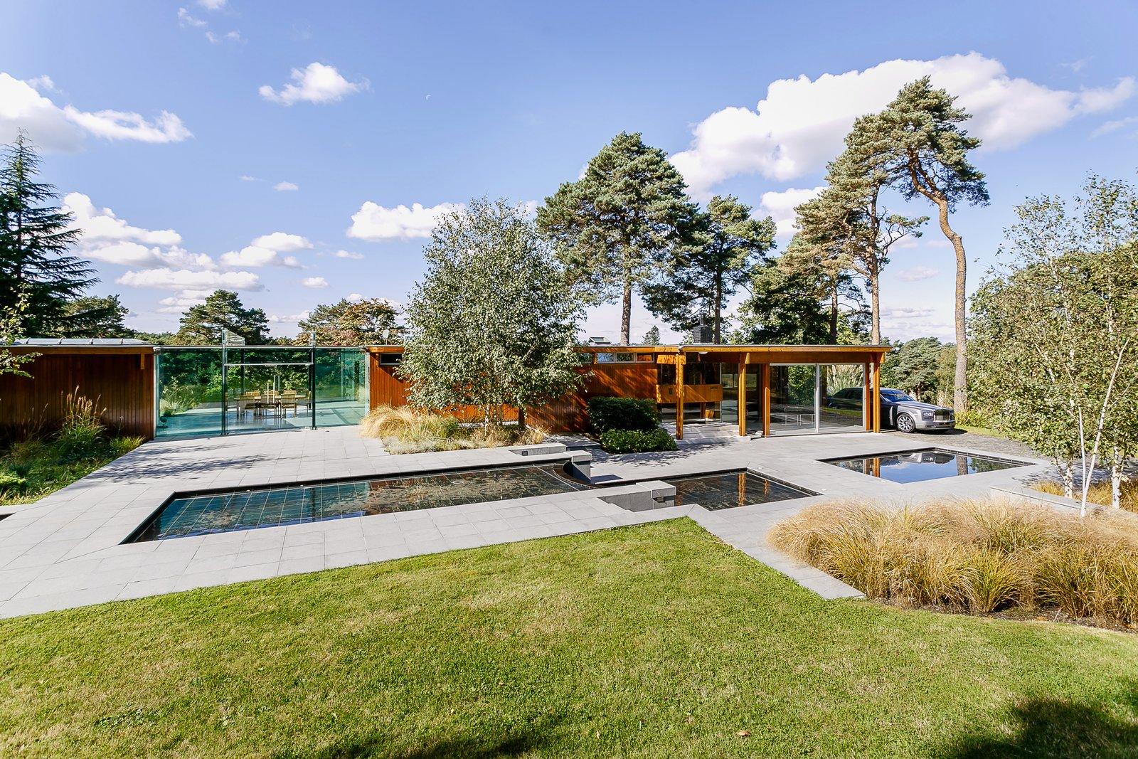 Outdoor, Front Yard, Walkways, Large, Trees, Grass, and Pavers  Best Outdoor Pavers Grass Photos from A Modernist Time Capsule by Erno Goldfinger Asks $4M