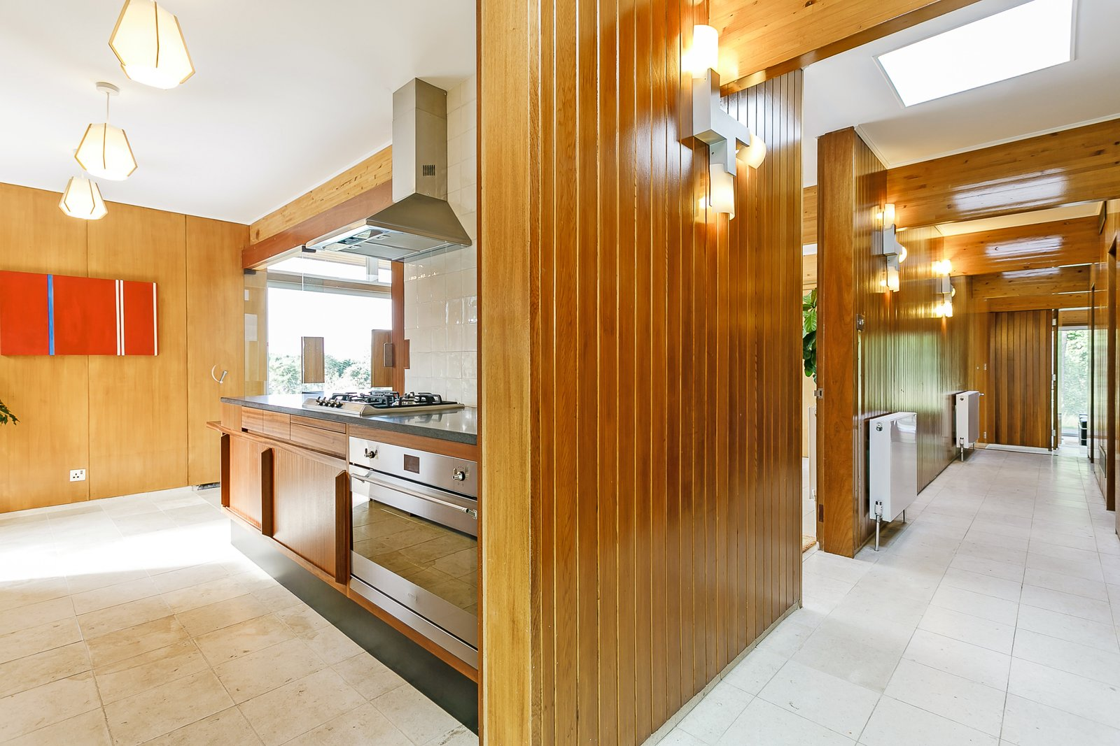 Kitchen, Wall Oven, Range, Wood, Wall, Ceiling, Range Hood, and Subway Tile  Best Kitchen Range Hood Ceiling Wall Oven Subway Tile Range Photos from A Modernist Time Capsule by Erno Goldfinger Asks $4M