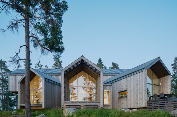 A Swedish Family's Dreamy Villa Fans Out For Lakeside Views