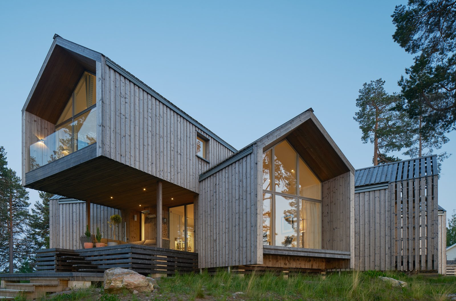 Exterior, Cabin Building Type, House Building Type, Gable RoofLine, Glass Siding Material, Wood Siding Material, and Metal Roof Material  Best Photos from A Swedish Family's Dreamy Villa Fans Out For Lakeside Views