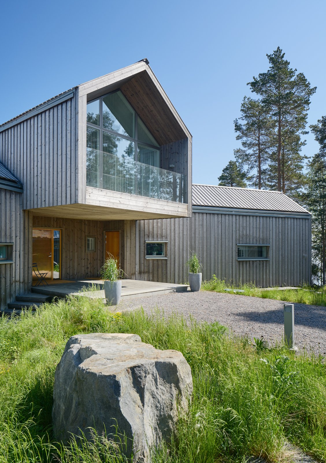 Exterior, Cabin, House, Wood, Gable, Glass, and Metal  Best Exterior Metal Wood House Glass Cabin Photos from A Swedish Family's Dreamy Villa Fans Out For Lakeside Views