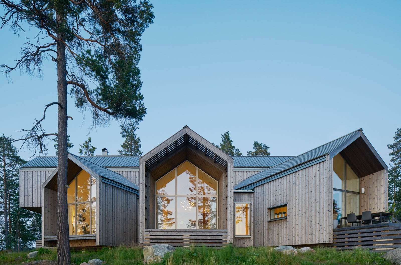 Exterior, House Building Type, Metal Roof Material, Wood Siding Material, Glass Siding Material, Gable RoofLine, and Cabin Building Type  Best Photos from A Swedish Family's Dreamy Villa Fans Out For Lakeside Views