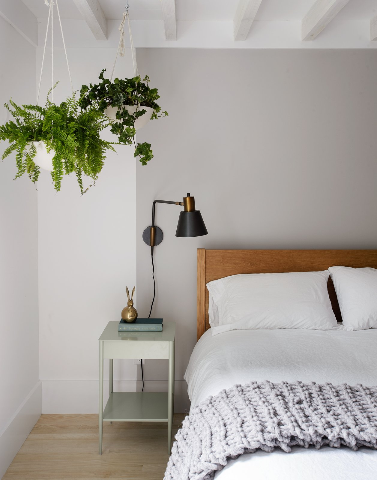Bedroom, Night Stands, Lamps, Light Hardwood, Wall, and Bed  Best Bedroom Wall Light Hardwood Lamps Photos from A Hamptons Beach Retreat Gets a Scandinavian-Style Makeover