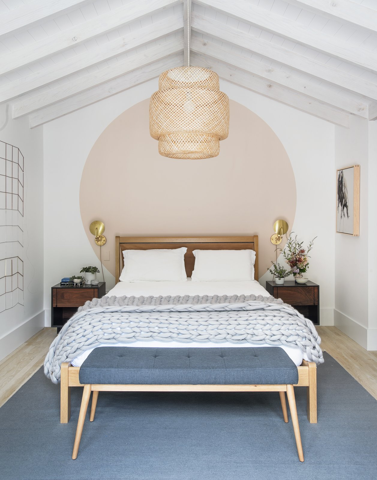 Bedroom, Lamps, Light Hardwood, Bed, Pendant, Wall, Bench, Night Stands, and Rug  Best Bedroom Wall Rug Light Hardwood Photos from A Hamptons Beach Retreat Gets a Scandinavian-Style Makeover