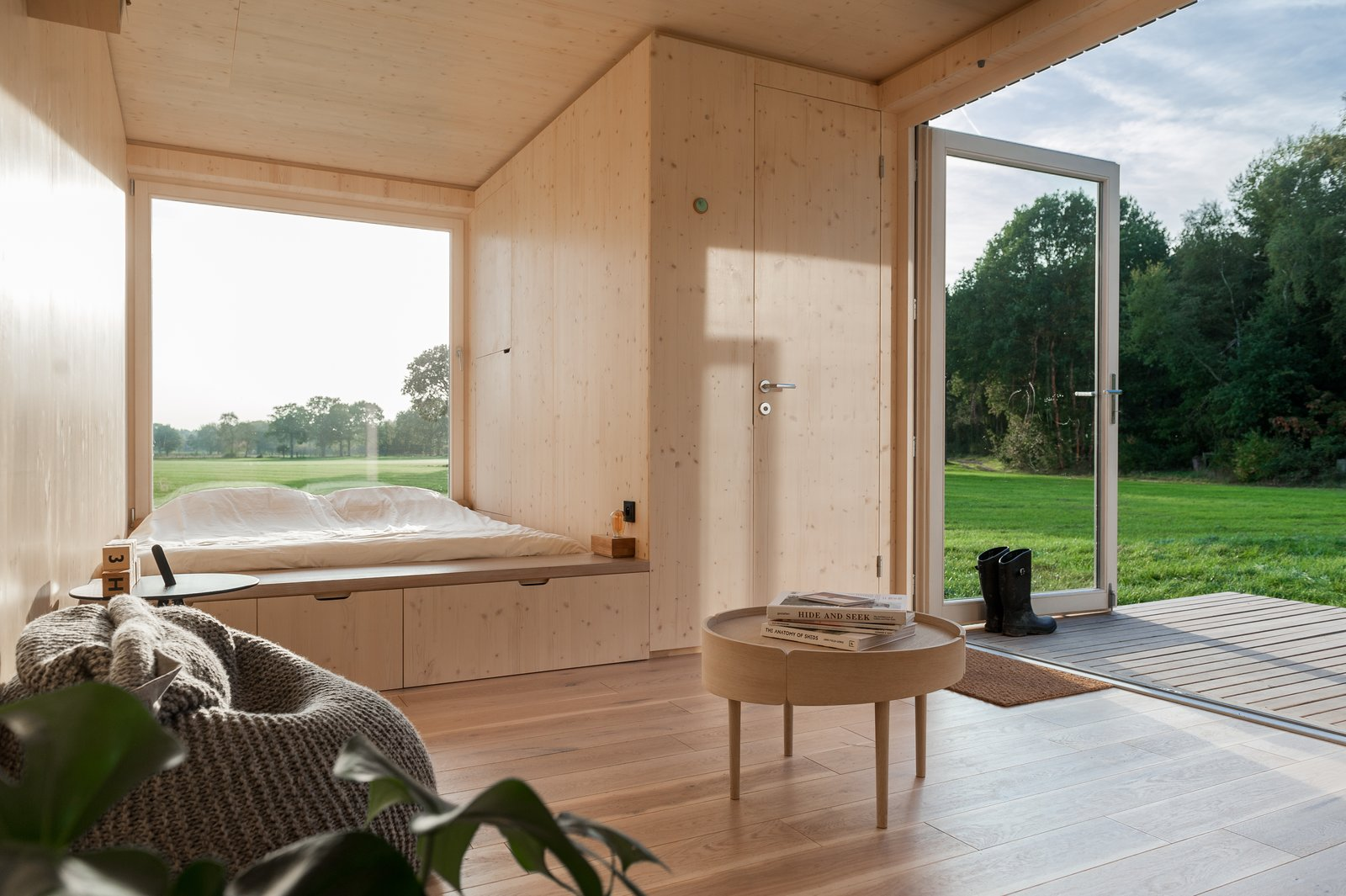 Bedroom, Light Hardwood Floor, Storage, and Bed  Photo 8 of 12 in These Off-the-Grid Cabins in Belgium Keep Their Locations Secret Until You Book