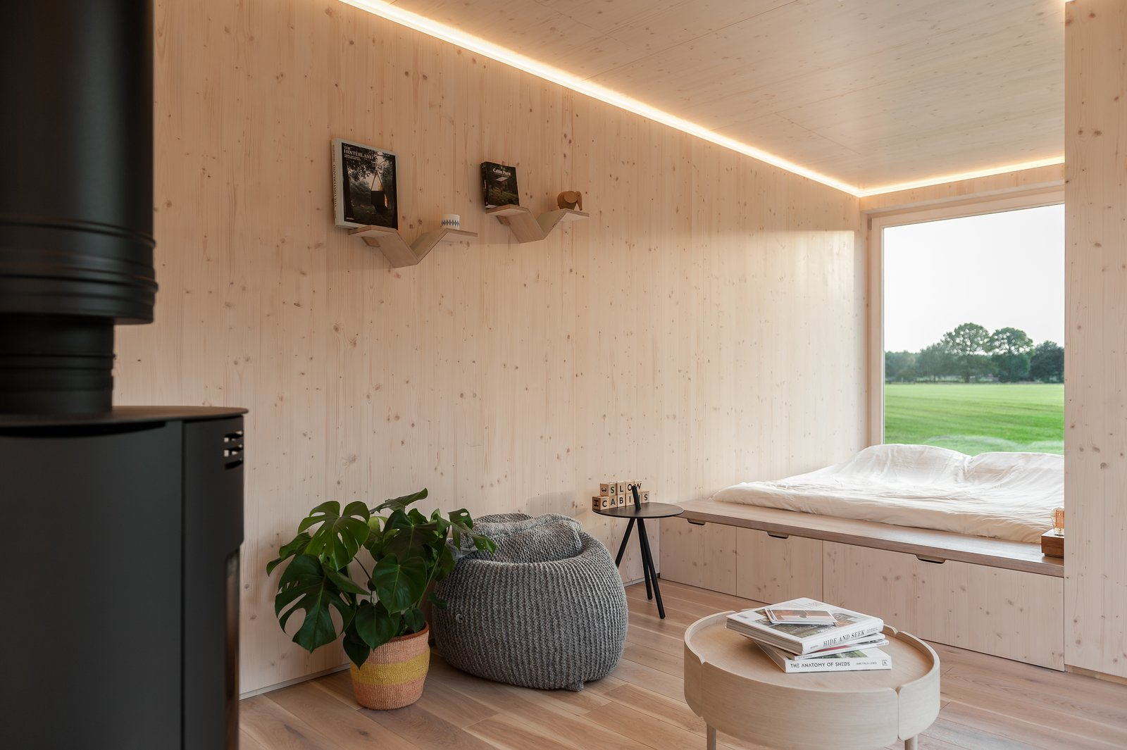 Bedroom, Storage, Bed, Recessed, Light Hardwood, and Shelves  Best Bedroom Shelves Recessed Bed Storage Photos from These Off-the-Grid Cabins in Belgium Keep Their Locations Secret Until You Book