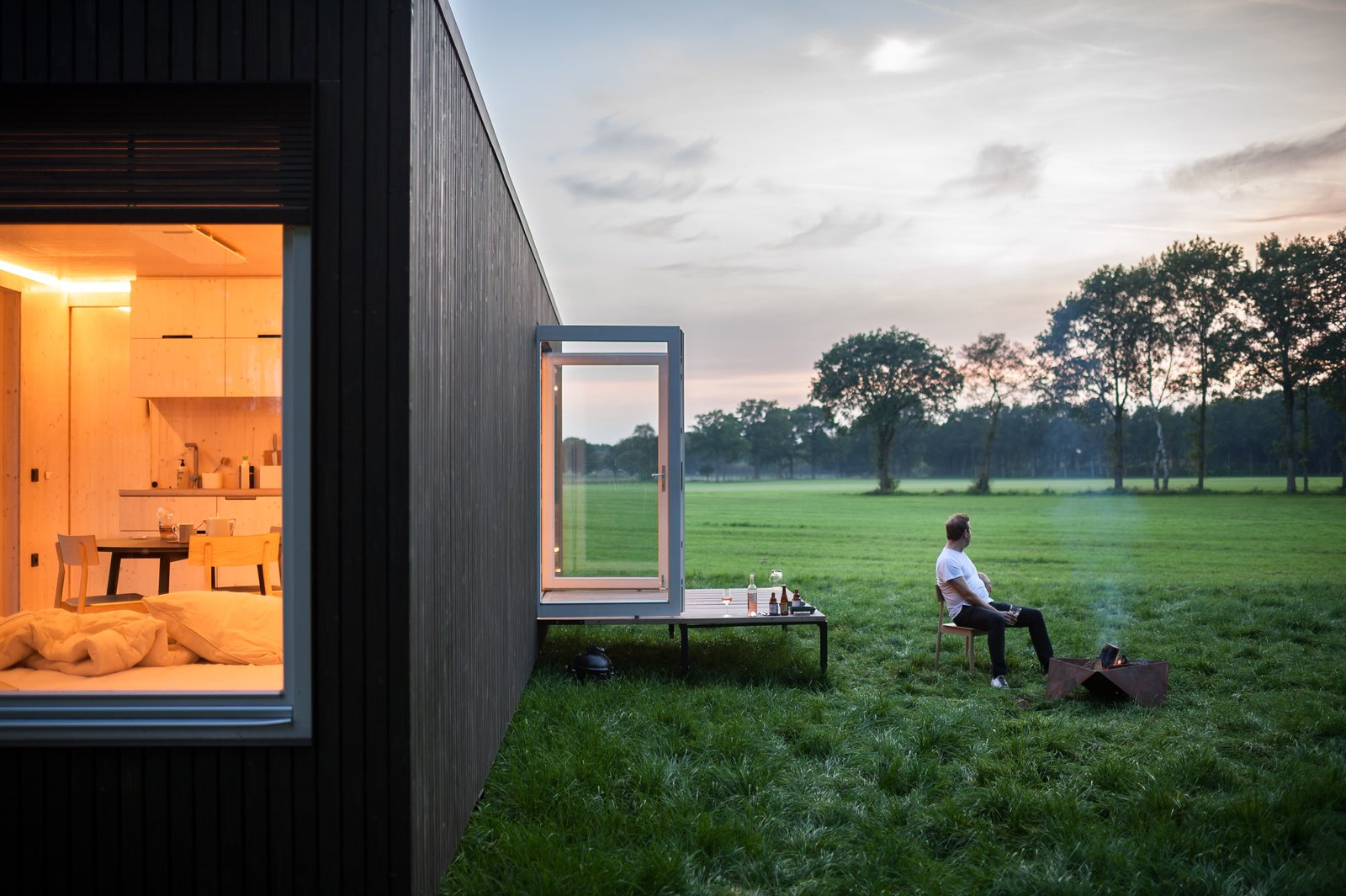 Outdoor, Field, Small Patio, Porch, Deck, Trees, and Grass  Photo 2 of 12 in These Off-the-Grid Cabins in Belgium Keep Their Locations Secret Until You Book
