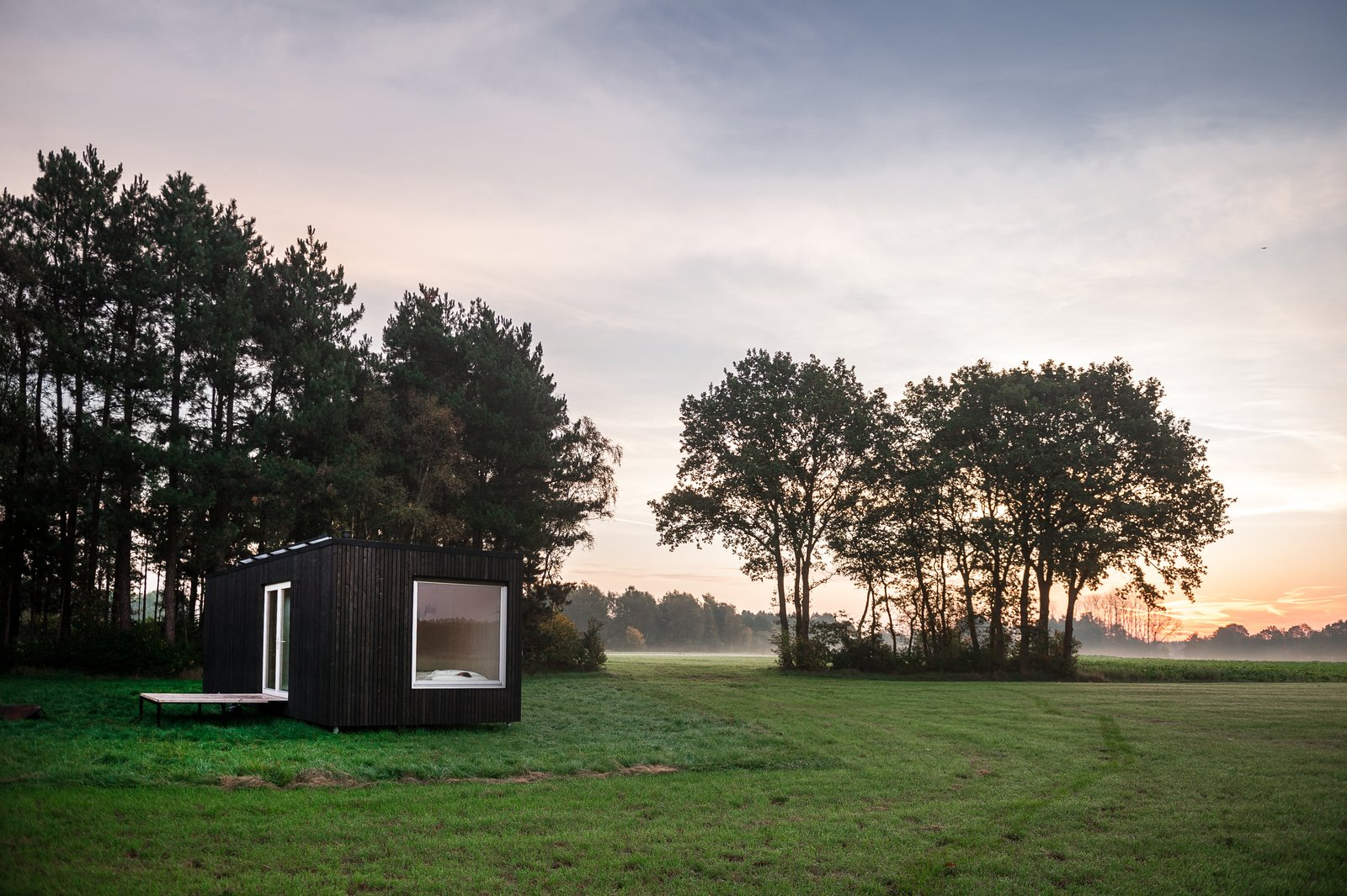 Exterior, Cabin Building Type, Flat RoofLine, Wood Siding Material, and Tiny Home Building Type  Photo 12 of 12 in These Off-the-Grid Cabins in Belgium Keep Their Locations Secret Until You Book