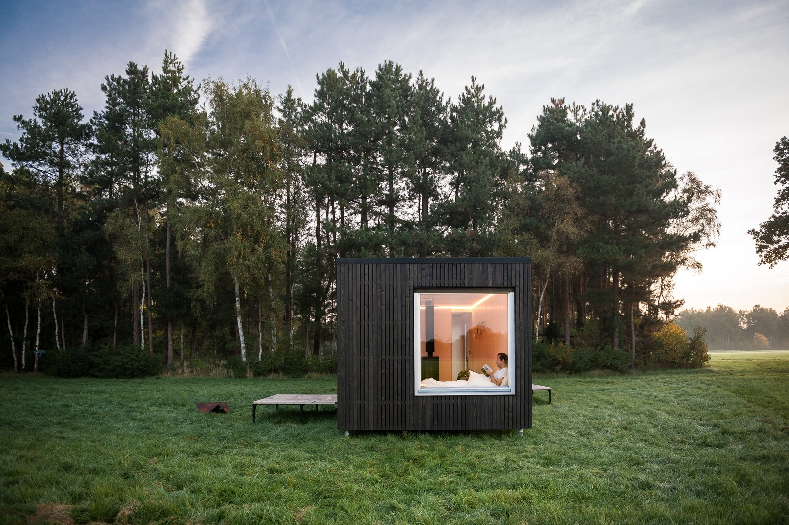 Outdoor, Trees, Field, Grass, and Small Patio, Porch, Deck  Photo 3 of 12 in These Off-the-Grid Cabins in Belgium Keep Their Locations Secret Until You Book