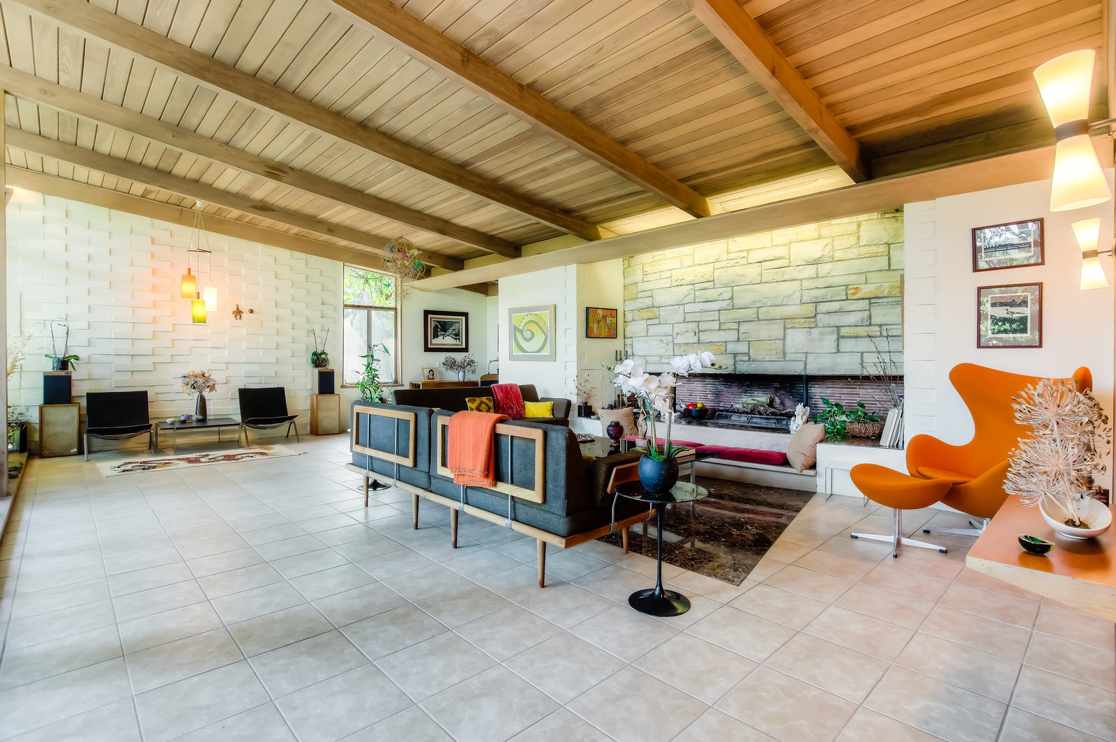 Living Room, Chair, Standard Layout Fireplace, Pendant Lighting, End Tables, Bench, Sofa, Coffee Tables, Ottomans, Wall Lighting, and Recliner  Photo 1 of 10 in An Exceptional Midcentury by Case Study Architect Pierre Koenig Hits the Market