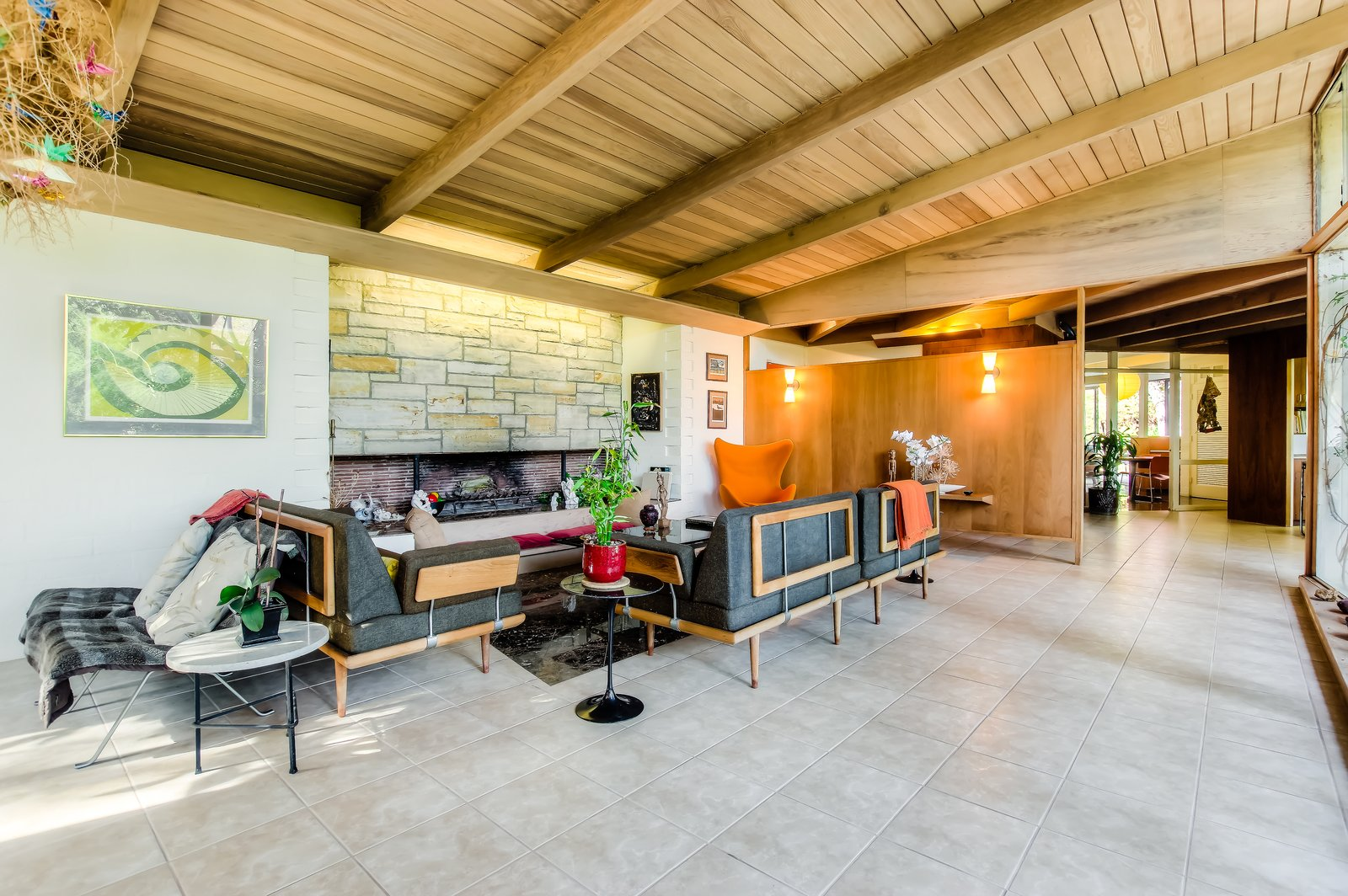 Living Room, Standard Layout Fireplace, Wall Lighting, Bench, Recliner, End Tables, Sofa, and Chair  Photo 2 of 10 in An Exceptional Midcentury by Case Study Architect Pierre Koenig Hits the Market