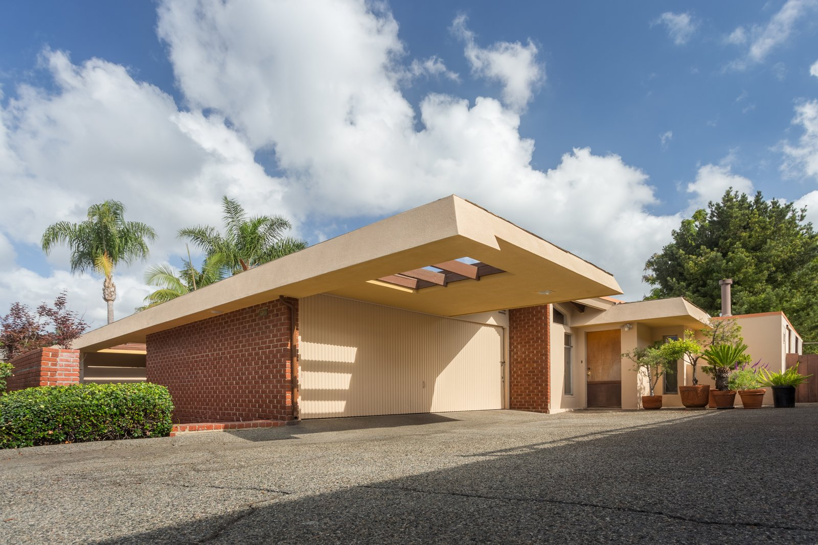 Exterior, Brick Siding Material, and House Building Type  Photo 1 of 6 in A Pristine John Lautner Home in Long Beach Is Available For the First Time