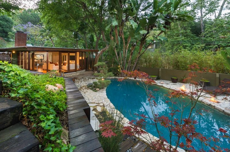 Outdoor, Stone Patio, Porch, Deck, Back Yard, Gardens, Large Pools, Tubs, Shower, Walkways, Hardscapes, Swimming Pools, Tubs, Shower, Shrubs, and Trees  Photo 16 of 16 in Anna Faris Lists Her Midcentury Abode in the Hollywood Hills For $2.5M