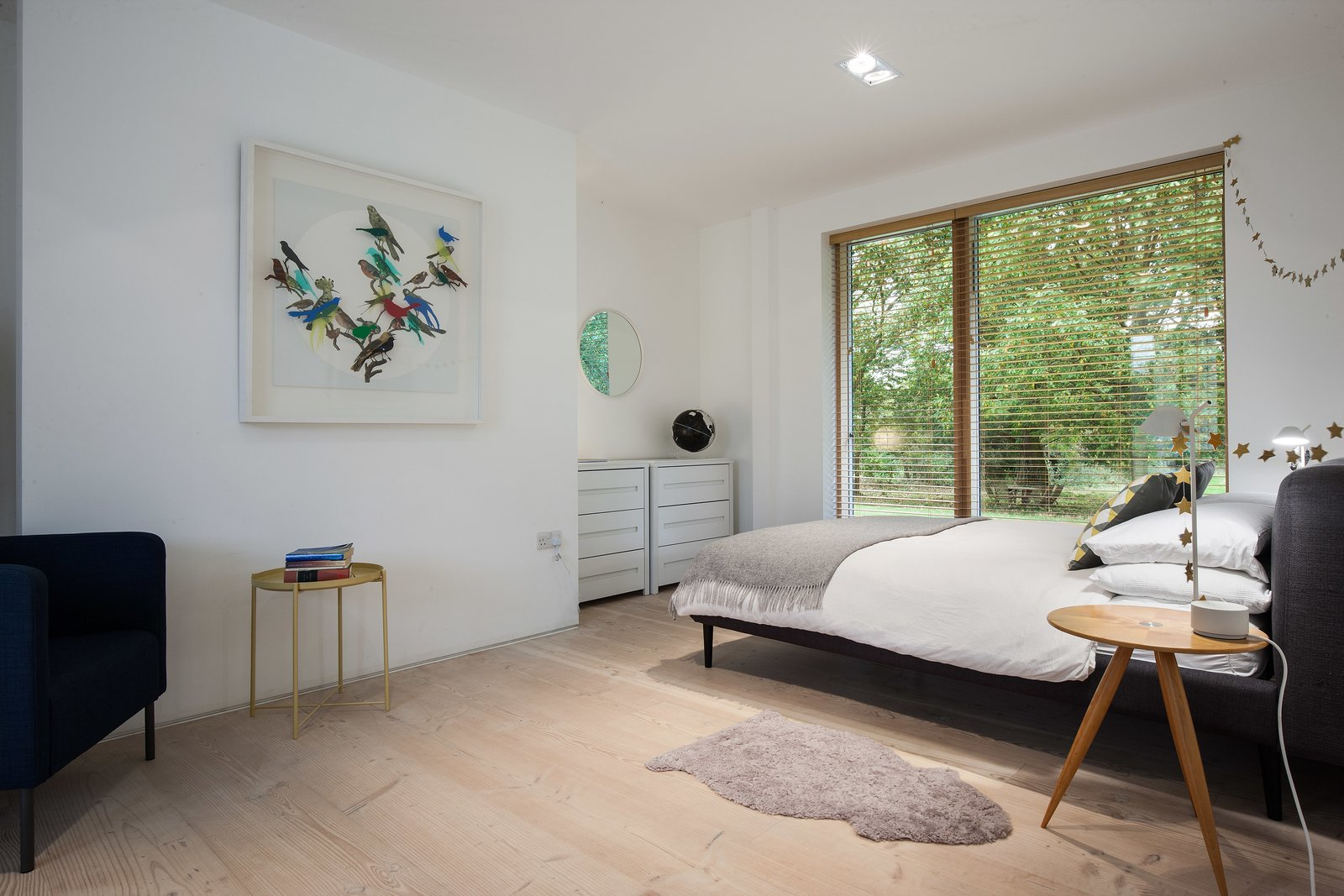 Bedroom, Bed, Chair, Light Hardwood Floor, Night Stands, Dresser, and Recessed Lighting  Photo 8 of 11 in A Scandinavian-Style Pavilion in England Is Listed For $2.1M