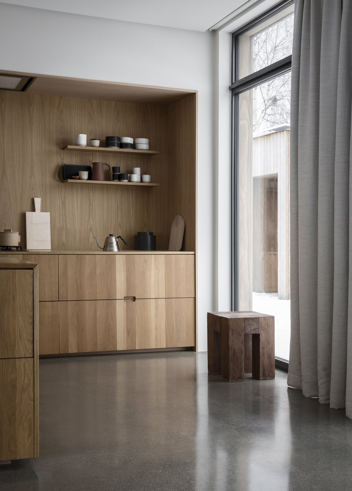 Kitchen, Concrete Floor, Wood Counter, Wood Cabinet, Range, Open Cabinet, and Wood Backsplashe  Photo 8 of 18 in A Cubic Dwelling in Norway Just Oozes Hygge