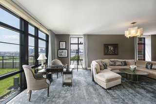 The enormous corner living room boasts stunning Hudson River views.
