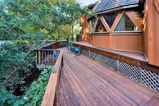 The deck looks out over a forested section of land.