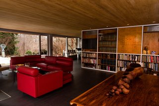 The open-plan living room features built-in bookshelves.