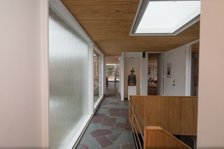 A skylight provides even more natural light to the central stairwell.