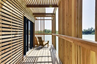 Drift Off in a Prefab Cabin at This Floating Hotel in France - Photo 6 of 13 - During the day, the experience inside the suite is a play of light and shadow with the sun filtering through the screening.