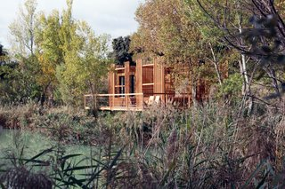 Drift Off in a Prefab Cabin at This Floating Hotel in France - Photo 5 of 13 - The privacy screens translate the elegant vertical movement of the reeds into a repetitive geometric pattern.
